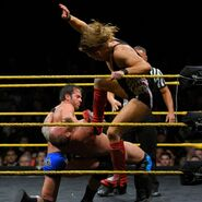Roderick and Pete Dunne double team on Eric Young