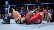 Nakamura with a cross armbreaker to Orton