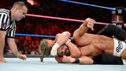 Roode down in a sleeper hold by Ziggler