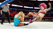 Asuka suddenly take control with a running kick to the face