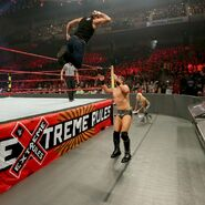 Dean diving elbow off on Miz