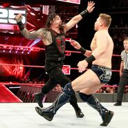 Reigns clothesline The Miz