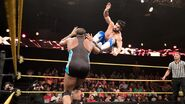Andrade-Almas drop kicking Angelo-Dawkins