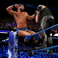 Roode fighting off Corbin top of the turnbuckle