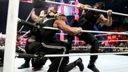 Dean-Ambrose and Roman-Reigns attacking The Rock