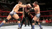 Primo and Epico attacking The Big Show
