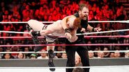 Ambrose clothesline Sheamus outta ring