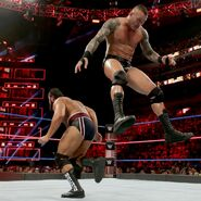 Orton jumps over Rusev