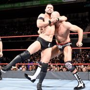 Balor putting Cesaro in a headlock