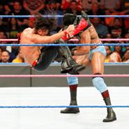 Nakamura lands a punishing kick to Mahal