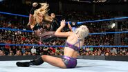 Natalya dropkick Charlotte