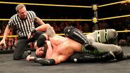 Samoa Joe puts Eric Young in a sleeperhold