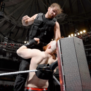 Ambrose punching Sheamus top of the turnbuckle