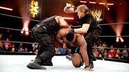 Reigns and Ambrose attacked Langston