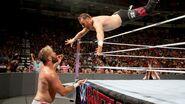 Sami-Zayn dive onto Mike-Kanellis