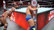 Cesaro throws Jason Jordan into the ring post