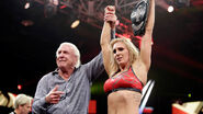 Charlotte with Ric-Flair winning the NXT Womens Champion
