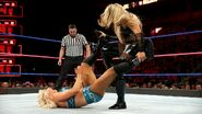 Natalya is ruthless as she stomps away at Charlotte's vulnerable joints