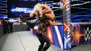 Natalya thrown Charlotte into the turnbuckle