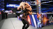 Natalya thrown Charlotte into the turnbuckle