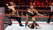 Jason-Jordan throw Curtis-Axel onto the turnbuckle