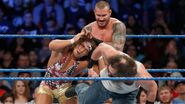 Randy Orton grabbing Chad Gable with Luke