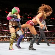 Asuka applies a painful ankle lock on Emma