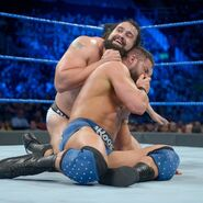 Rusev puts Roode in a headlock