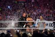 Undertaker facing Triple H