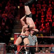 Cesaro suplexes Balor off the turnbuckle