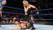 Natalya goes for an early Sharpshooter