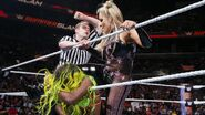 Natalya using the rope hurting on Naomi