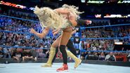 The Princess of Staten Island Carmella with a devastating kick as soon as the match starts
