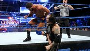 Corbin punches Roode back in the ring