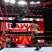 Jeff jumps off the ring post on Mahal
