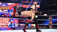 Kevin-Owens hit Styles with a clothesline