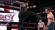 Reigns delivering a supeman punch to Cena