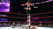 Neville standing on the turnbuckle