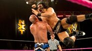 Reigns punches Donovan