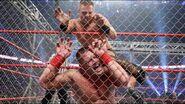 The-Miz kneeing Cena against the steel Cage