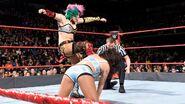Asuka kicking her opponent