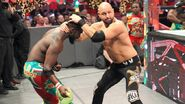 Kofi Kingston batting Karl Anderson