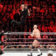 Ambrose hits Cesaro with an elbow