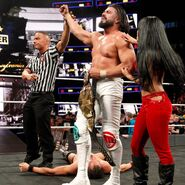 Almas and Vega celebrate his NXT Championship victory