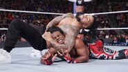 Jey headlock on Xavier-Woods