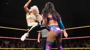 Liv-Morgan delivering a kick to Peyton-Royce