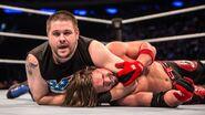 Owens headlocking Styles at MSG