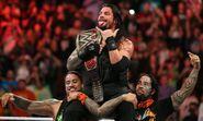 Roman Reigns celebrates winning
