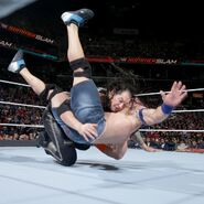 Corbin slam Cena onto the mat