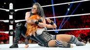 Tamina grappling Becky